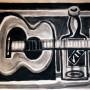 Pituco. Bodegón cubista (guitarra y botella). Técnica mixta sobre cartulina. 32,5 x 45 cm. Firmado Pituco (esquina inferior izquierda). p.v.p obra enmarcada: 1250 € + IVA = 1512.5 €